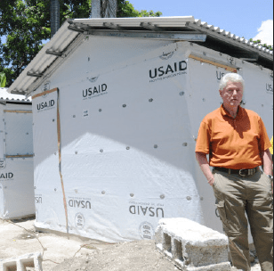 "Bill Clinton in front of one of his 6 billion dollar ""Haiti"" houses"